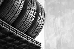 Car tires on grey background. Closeup stock images