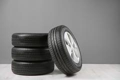 Car tires near   wall. Car tires near gray wall Royalty Free Stock Image