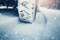 Free Car Tires On Winter Road Covered With Snow Stock Image - 126778281
