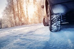 Free Car Tires On Winter Road Covered With Snow Stock Photography - 129949532