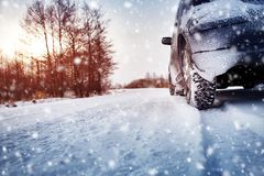 Free Car Tires On Winter Road Covered With Snow Stock Images - 129952814