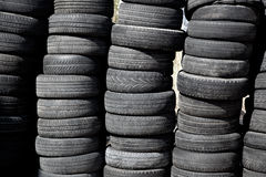 Car tires pneus stacked in rows Royalty Free Stock Images