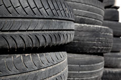 Car tires pneus stacked in rows Royalty Free Stock Image