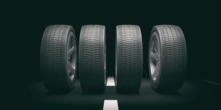 Car tires and rims on black background. 3d illustration. Car wheels on black road background. 3d illustration Royalty Free Stock Image