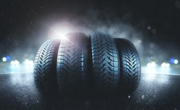Car tires on a road. Winter snow transport stock photo