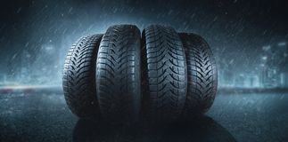Car tires on a rain road. Car tires on a road winter snow transport stock photography