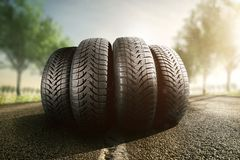 Car tires on a summer road. Car tires on a road winter snow transport royalty free stock photo