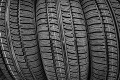 Car tires in a row on a shelf tire. Protector of automobile tires. A number of automobile tires. Close up view on auto mobile new wheel tire surface stock photo