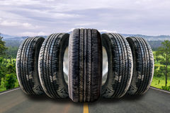 Car tires in row on the street Royalty Free Stock Photo