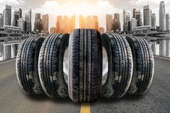 Car tires in row on the street Stock Image