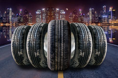 Car tires in row on the street Stock Images