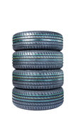 Car tires - set of four on white Stock Photos