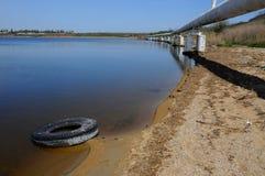 Car tires on the shore Hadzhibeysky estuary Royalty Free Stock Image