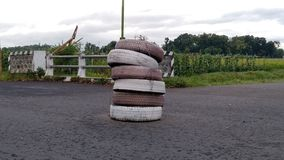 Car tires stack in the middle of the road royalty free stock image