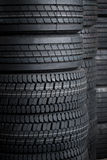 Car tires stack tire in store house. At sale at a tire store Stock Photos