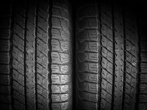Tires. Car tires texture in the dark background stock image