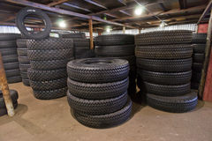 Car tires on warehouse. Black car tires on warehouse Royalty Free Stock Photos