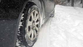 Car tires on winter road Royalty Free Stock Photos
