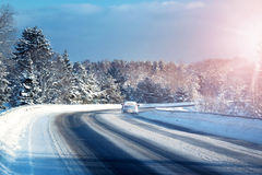 Car tires on winter road Stock Images