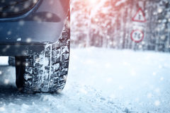 Car tires on winter road Royalty Free Stock Photo
