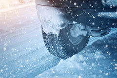 Car tires on winter road Royalty Free Stock Image