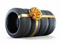 Car tires wrapped in a gift ribbon with a bow 3D Royalty Free Stock Photography