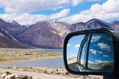 In the car to the Himalayan Pangong Tso lake with rear view refl Royalty Free Stock Photo
