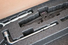 Car tools in trunk with rolling jack. In the trunk of car Stock Photo