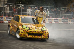 Car toons drift by Terry Grant stock photos