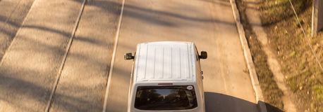 Car top view. Top view of white car moving on the track Royalty Free Stock Photos