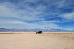 Car tour in Atacama desert, Chile. Car tour, 4x4 off-road car in empty Atacama desert. Volcanos on the horizont in Atacama desert, Chile Stock Image