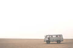 Car with tourists in desert on Olkhon island. Lake Baikal, Russian Siberia Royalty Free Stock Photo