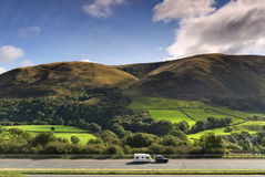 Car towing caravan on M6 Royalty Free Stock Photo