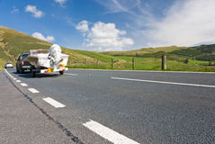 Car towing motor boat. On a mountain road in Wales, UK Stock Photos