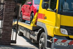 Car Towing Service. Modern Sport Utility Vehicle on the Towing Truck. Broken Car stock photo