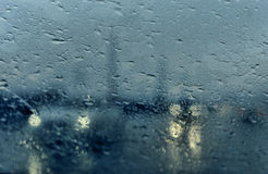 Car in town in rainy day. Royalty Free Stock Photography