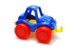 Car Toy. Small Color Plastic Car Toy Isolated on White with Shadow royalty free stock photos