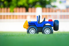 Car toy  on field of green grass. Thailand Stock Images