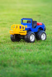 Car toy  on field of green grass Royalty Free Stock Images