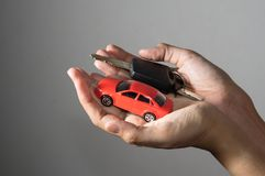 Car toy and key in hand. Car toy and key in woman hand Stock Image