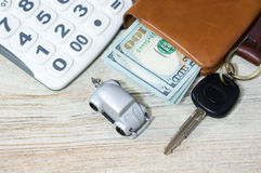 Car toy with key and money Stock Photo