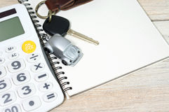 Car toy with key on notebook Royalty Free Stock Images