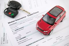 Car toy and keys on insurance documents. Protection car concept royalty free stock photos