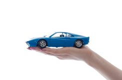 Car toy on palm. Isolated on white Royalty Free Stock Photos