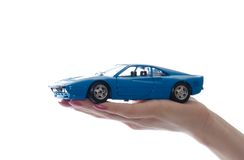 Car toy on palm. Isolated on white Stock Photos