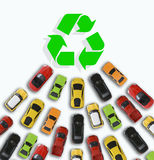 Car toys heading towards a green energy symbol or sign suggesting sales growth of electric vehicles Royalty Free Stock Images