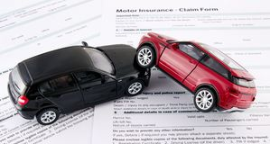 Car toys on motor insurance claim form Royalty Free Stock Photos