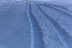Car traces in snow Stock Photos
