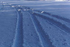 Car traces in snow Royalty Free Stock Photos