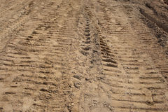 Car track and Caterpillar track on dry clay Royalty Free Stock Photography